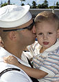 e_Controlman_1st_Class_Kris_McGuire,_stationed_aboard_guided_missile_destroyer_USS_O'Kane_(DDG_77),_kisses_his_son_goodbye_as_he_prepares_to_get_underway